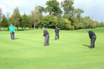 Pop Robson and John Craggs lining up putts on the 5th green